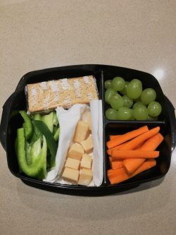 My snack box has portion of wholegrain crackers, bell pepper and carrot sticks, grapes and few cubes of Parmesan cheese. Yummy and healthy!